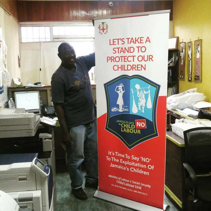 Retractable pull-up banner design, print and assembled for the Ministry of Labour Jamaica